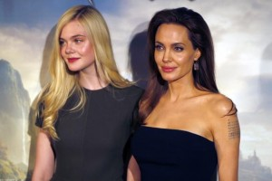"""Actresses Angelina Jolie and Elle Fanning pose during a photocall for the film """"Maleficent"""" in Paris"""