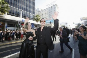 "Cast member Jolie and actor Pitt wave at fans as they arrive at the premiere of ""Maleficent"" at El Capitan theatre in Hollywood"