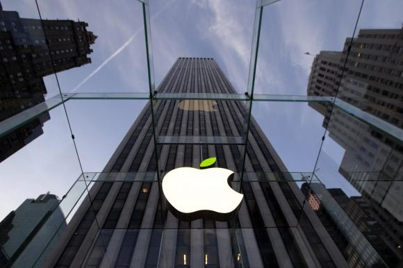 The leaf on the Apple symbol is tinted green at the Apple flagship store on 5th Ave in New York April 22, 2014. Employees and signage have been themed green to mark Earth Day. CREDIT: REUTERS/BRENDAN MCDERMID