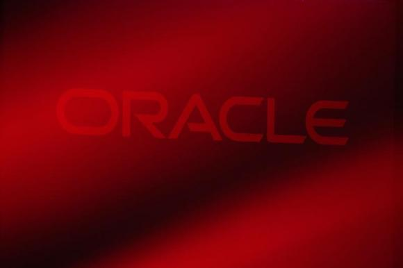 An Oracle Corporation logo is seen on stage prior to the announcement of the company's latest SPARC servers at Oracle Conference Center in Redwood Shores, California March 26, 2013. CREDIT: REUTERS/STEPHEN LAM