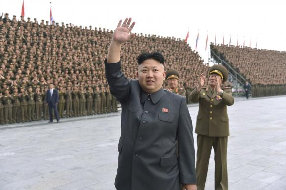 North Korean leader Kim Jong Un attends a photo session with KPA Unit 267 soldiers, who performed labour to remodel the Songdowon International Children's camp, in this undated photo released by North Korea's Korean Central News Agency (KCNA) in Pyongyang May 3, 2014. CREDIT: REUTERS/KCNA