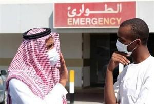 Reuters File photo.  Men wearing surgical masks as a precautionary measure against the novel coronavirus, speak at a hospital in Khobar city.