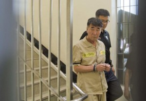 """Lee Joon-seok, captain of sunken ferry Sewol, arrives at a court in Gwangju June 10, 2014. Fifteen crew of a South Korean ferry that sank in April killing more than 300 people, mostly children, went on trial on Tuesday on charges ranging from negligence to homicide, with the shout going up of """"murderer"""" as the captain entered the packed court.  REUTERS/Korea Pool/Yonhap"""