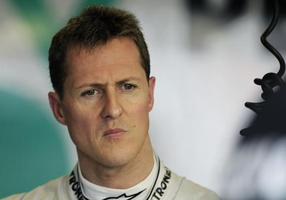 Mercedes Formula One driver Michael Schumacher of Germany is seen in the pits during the first practice session of the Australian F1 Grand Prix at the Albert Park circuit in Melbourne March 25, 2011. CREDIT: REUTERS/MARK HORSBURGH