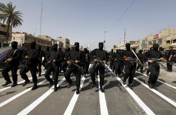 Mehdi Army fighters loyal to Shi'ite cleric Moqtada al-Sadr take part during a parade in Baghdad's Sadr city June 21, 2014. CREDIT: REUTERS/AHMED SAAD