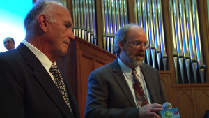 Arthur E. Sclueter, Jr., (left) president and founder of A.E. Schlueter Pipe Organ Company, with a member of his senior staff Peter Duys, attended the worship service of the Iglesia Ni Cristo where the pipe organ they built was first publicly played.  In the background is one of the pipe organ panels.  The INC Central Temple pipe organ consisted of 3,162 individual pipes.  (Photo grabbed from INCTV video)