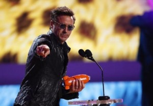 Actor Robert Downey Jr. accepts the award for favorite male buttkicker at the 27th Annual Kids' Choice Awards in Los Angeles, California March 29, 2014. Credit: Reuters/Mario Anzuoni