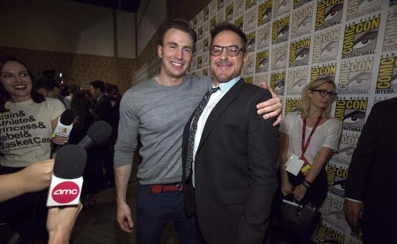 Cast members Robert Downey Jr. (R) and Chris Evans pose at a press line for 'Avengers: Age of Ultron' during the 2014 Comic-Con International Convention in San Diego, California July 26, 2014. Credit: Reuters/Mario Anzuoni