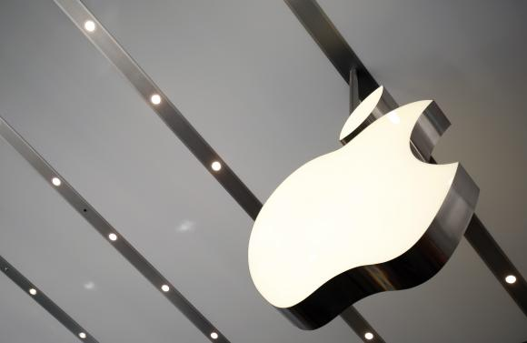 The Apple logo is pictured inside the newly opened Omotesando Apple store at a shopping district in Tokyo June 26, 2014. Credit: Reuters/Yuya Shino/Files