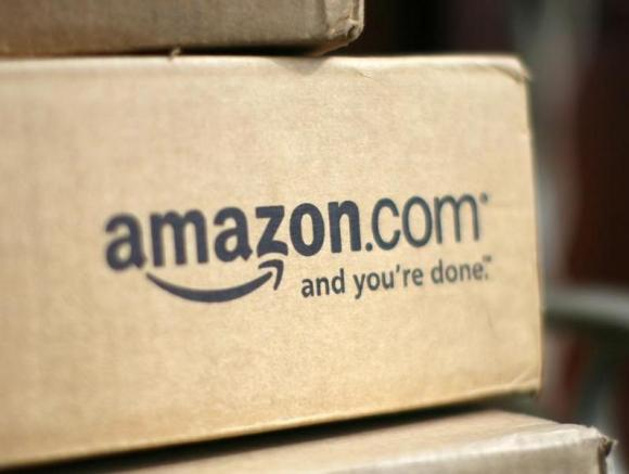 A box from Amazon.com is pictured on the porch of a house in Golden, Colorado July 23, 2008. Credit: Reuters/Rick Wilking