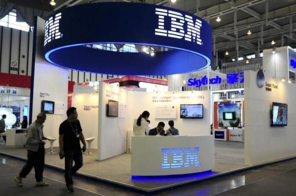 Visitors walk past the IBM booth at the 9th China International Software Product & Information Service Expo in Nanjing, Jiangsu province September 6, 2013. Credit: Reuters/China Daily