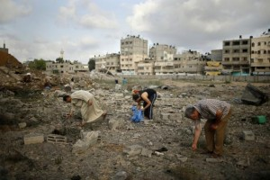 Palestinians search for scattered body parts amongst the rubble of Tayseer Al-Batsh's family house, which police said was destroyed in an Israeli air strike in Gaza City July 13, 2014. Credit: Reuters/Mohammed Salem