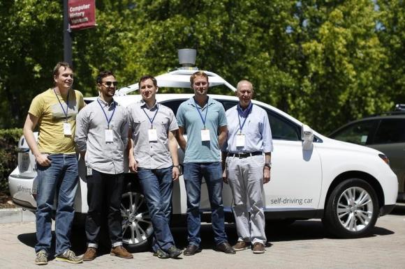 Google self-driving car team poses in Moutinain View, California