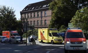 An employee of the WHO, who contracted Ebola in Sierra Leone, arrives at the 'Universitaetsklinikum Hamburg-Eppendorf ' in an ambulance, in Hamburg