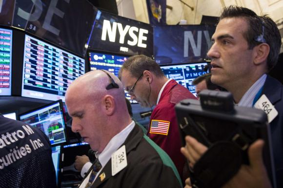 Traders work on the floor of the New York Stock Exchange August 12, 2014.  Credit: Reuters/Brendan McDermid