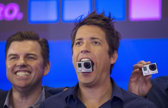 GoPro Inc's founder and CEO Nick Woodman holds a GoPro camera in his mouth at GoPro Inc's IPO at the Nasdaq Market Site in New York City in this file photo taken June 26, 2014. Credit: Reuters/Mike Segar/Files
