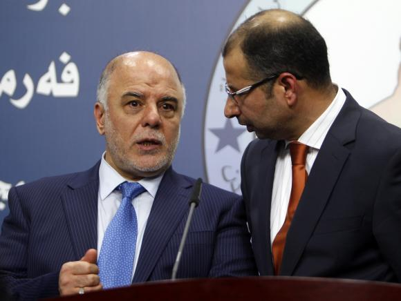 Salim al-Jabouri (R), speaker of the Iraqi Council of Representatives, and Haider Abadi (L), a member of Iraqi Prime Minister Nuri al-Maliki's State of Law bloc, speak during a news conference in Baghdad, July 15, 2014. Credit: Reuters/Ahmed Saad