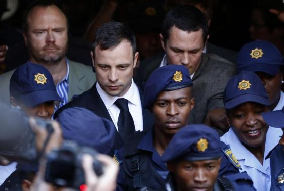 South African Olympic and Paralympic sprinter Oscar Pistorius leaves the North Gauteng High Court in Pretoria, September 12, 2014.  Credit: Reuters/Mike Hutchings