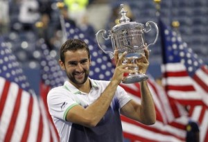 Cilic of Croatia poses with his trophy after defeating Nishikori of Japan in their men's singles final match at the 2014 U.S. Open tennis tournament in New York