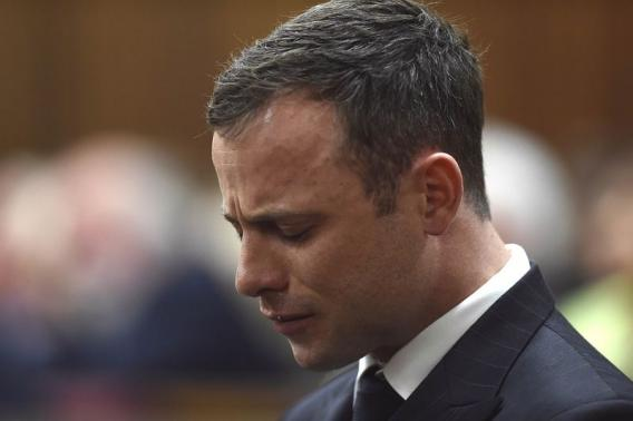 Olympic and Paralympic track star Oscar Pistorius reacts during judgement at the North Gauteng High Court in Pretoria, September 11, 2014.   REUTERS/Phill Magakoe/Pool