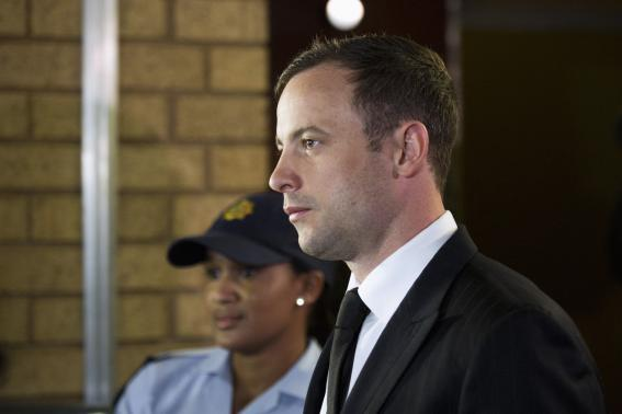 South African Olympic and Paralympic track star Oscar Pistorius arrives at the North Gauteng High Court in Pretoria, September 12, 2014.    Courtesy REUTERS/Rogan Ward