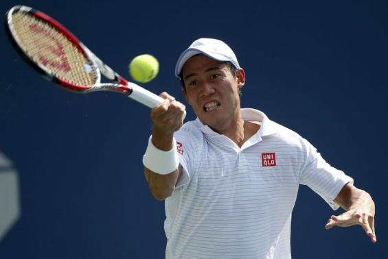 Kei Nishikori of Japan hits a return to Novak Djokovic of Serbia during their semi-final match at the 2014 U.S. Open tennis tournament in New York, September 6, 2014. CREDIT: REUTERS/RAY STUBBLEBINE