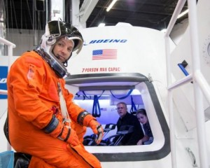 """NASA astronaut Randy Bresnik prepares to enter Boeing's CST-100 spacecraft for a fit check evaluation at the company's Houston Product Support Center in this undated image. NASA will partner with Boeing and SpaceX to build commercially owned and operated """"space taxis"""" to fly astronauts to the International Space Station, ending U.S. dependence on Russia for rides, officials said on Tuesday.    REUTERS/NASA/Handout via Reuters"""