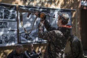 A pro-Russian rebel checks his rifle inside the Vostok (East) battalion base in Donetsk, eastern Ukraine, September 17, 2014. Credit: Reuters/Marko Djurica