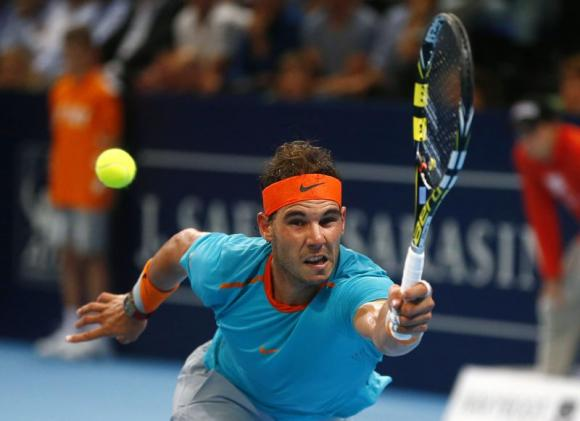 Spain's Rafael Nadal returns the ball to Simone Bolelli of Italy during their tennis match at the Swiss Indoors ATP tournament in Basel October 20, 2014. CREDIT: REUTERS/ARND WIEGMANN
