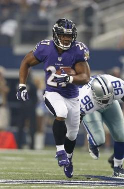 Aug 16, 2014; Arlington, TX, USA; Baltimore Ravens running back Ray Rice (27) runs with the ball in the second quarter against Dallas Cowboys defensive end George Selvie (99) at AT&T Stadium. Mandatory Credit: Matthew Emmons-USA TODAY Sports