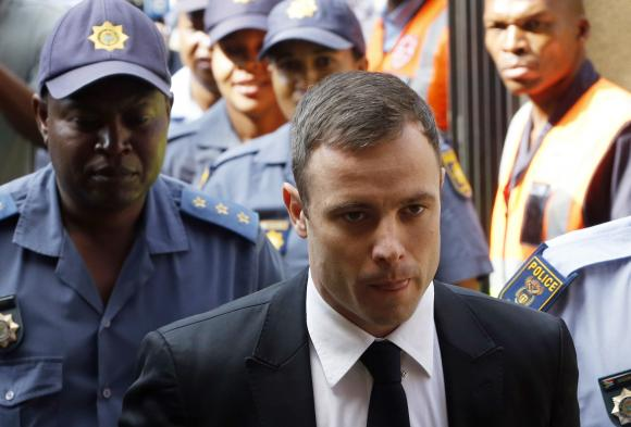 South African Olympic and Paralympic sprinter Oscar Pistorius arrives at the North Gauteng High Court in Pretoria, October 16, 2014. CREDIT: REUTERS/MIKE HUTCHINGS