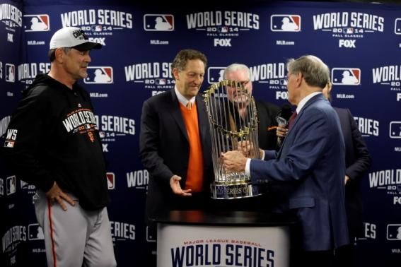 MLB commissioner Bud Selig (right) presents San Francisco Giants manager Bruce Bochy (left) , chief executive officer Larry Baer (middle) and general manager Brian Sabean with the Commissioners Trophy after game seven of the 2014 World Series against the Kansas City Royals at Kauffman Stadium. Charlie Neibergall/Pool Photo via USA TODAY Sports