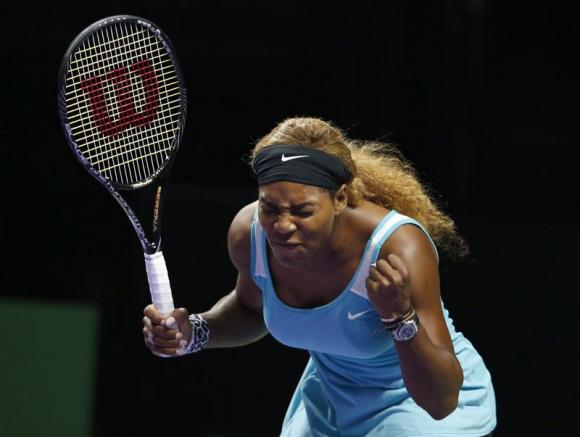 Serena Williams reacts as she plays against Simona Halep of Romania during their WTA Finals singles tennis match at the Singapore Indoor Stadium October 22, 2014. CREDIT: REUTERS/EDGAR SU