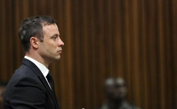 South African Olympic and Paralympic track star Oscar Pistorius attends his sentencing at the North Gauteng High Court in Pretoria October 21, 2014. CREDIT: REUTERS/THEMBA HADEBE/POOL