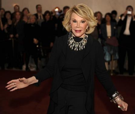 Comedian Joan Rivers poses for photographers as she arrives for the Kennedy Center's Mark Twain Prize for American Humor Gala in Washington November 10, 2008.  REUTERS/Mike Theiler
