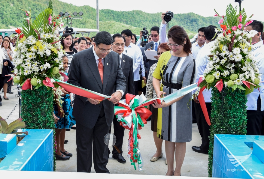 Iglesia Ni Cristo Executive Minister Eduardo V. Manalo and his wife Lynn Manalo lead the ribbon cutting ceremonies during the inauguration on January 23, 2015 of the EVM Self-Sustainable Resettlement Community in Sitio New Era, Bgy. Langit, Alangalang, Leyte.  The community consists of 500 housing units now ready for occupancy, and another 500 units to be constructed within the year, for typhoon Yolanda survivors. (Photo courtesy INC Executive News)