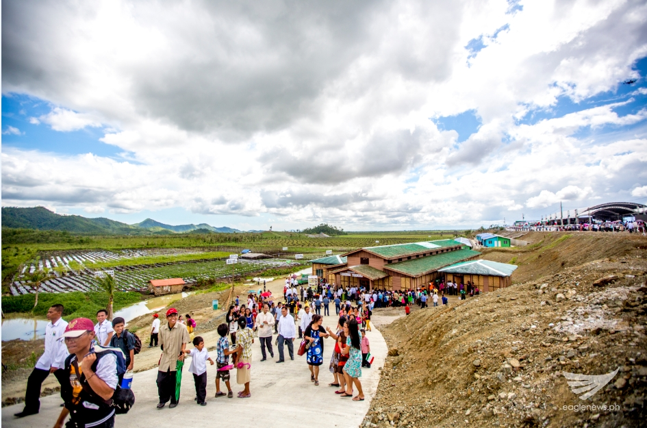 People visiting the  mushroom production and processing facility at the EVM Self-Sustainable Resettlement Community in Bgy. Langit, Alangalang, Leyte. (Photo courtesy INC Executive News)