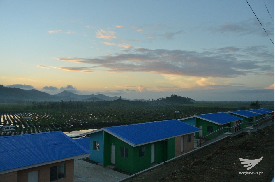 A few of the 500 housing units (quadruple style) of the EVM Self-Sustainable Resettlement Community in Sitio New Era, Bgy. Langit, Alangalang, Leyte for the typhoon Yolanda survivors. The eco-farming site is in the background. (Photo courtesy FYM Foundation)