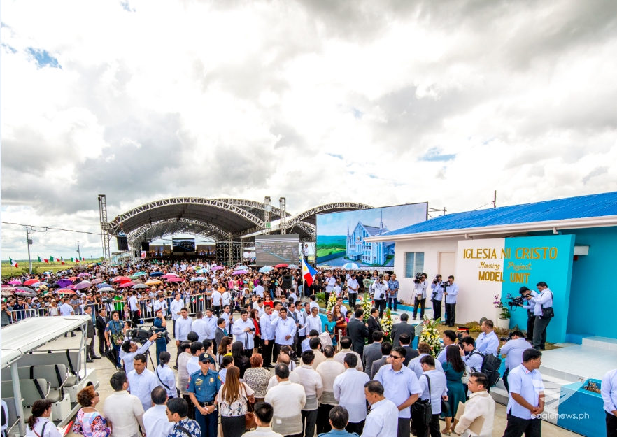 The inauguration of the Iglesia Ni Cristo's housing project for Yolanda survivors, called the EVM Self-Sustainable Resettlement Community in Sitio New Era, Bgy. Langit, Alangalang, Leyte on Friday, January 23, 2015.  The event led by INC Executive Minister Eduardo V. Manalo was preceded by a special worship service where 24 new ministers, including a South African, 2 Japanese and a German, were ordained in a huge makeshift tent in the area as seen in the background. (Photo courtesy INC Executive News)