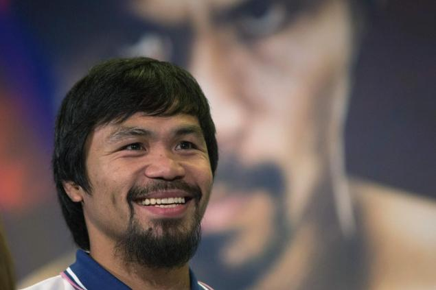 Manny Pacquiao is taking on another role as the boxing star signs on to coach basketball. Photo by SHANNON STAPLETON/Reuters