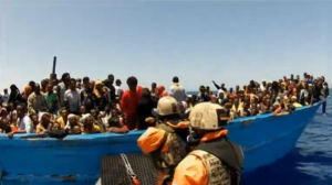 The Germany navy rescues 627 people in the Mediterranean before handing them over to Italian authorities at the port of Reggio Calabria in southern Italy.  (Photo grabbed from Reuters video/Courtesy Reuters)
