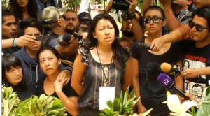 Ruben Espinosa's sister, Patricia, speaking during her brother's funeral.  (Photo grabbed from Reuters video)