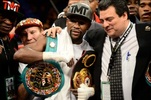 Floyd Mayweather defeats Andre Berto in unanimous decision to move his record to 49-0 and tie Rocky Marciano's record. (Courtesy USA Today Sports images.)