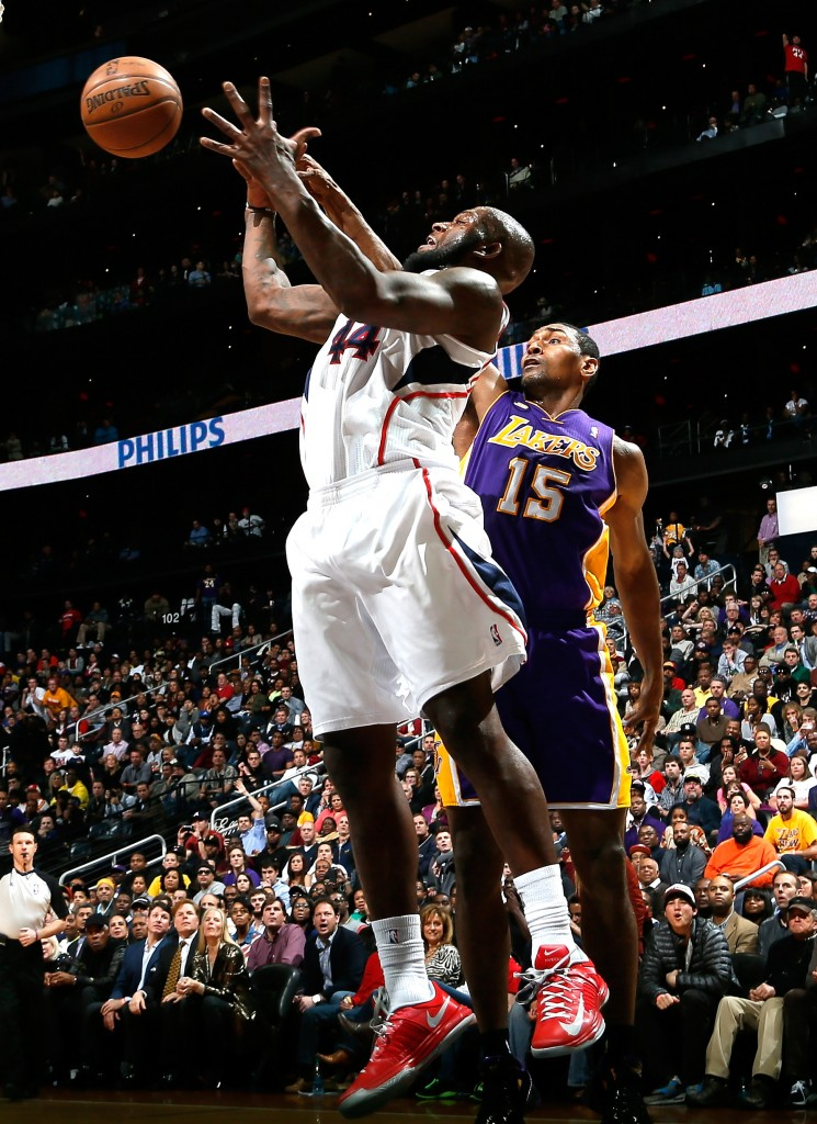 ATLANTA, GA - MARCH 13: Ivan Johnson #44 of the Atlanta Hawks battles for a rebound against Metta World Peace #15 of the Los Angeles Lakers at Philips Arena on March 13, 2013 in Atlanta, Georgia. NOTE TO USER: User expressly acknowledges and agrees that, by downloading and or using this photograph, User is consenting to the terms and conditions of the Getty Images License Agreement. Kevin C. Cox/Getty Images/AFP