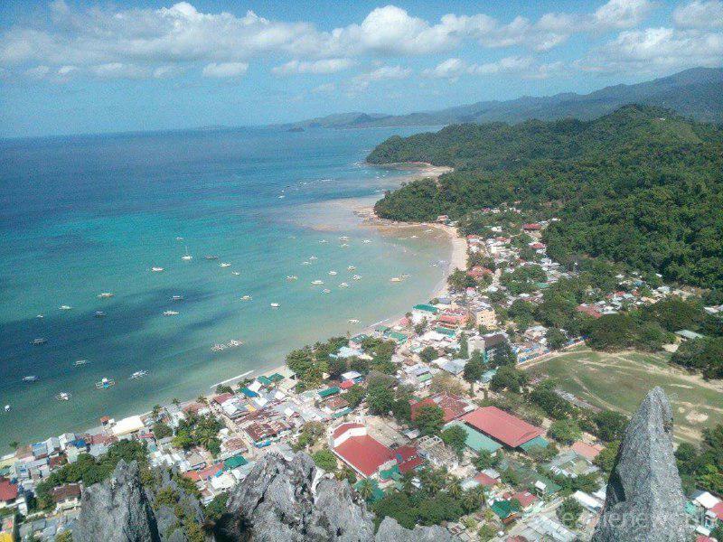 Houses, rocks and the vast sea of El Nido (by Jonathan Velez) Eagle News Service