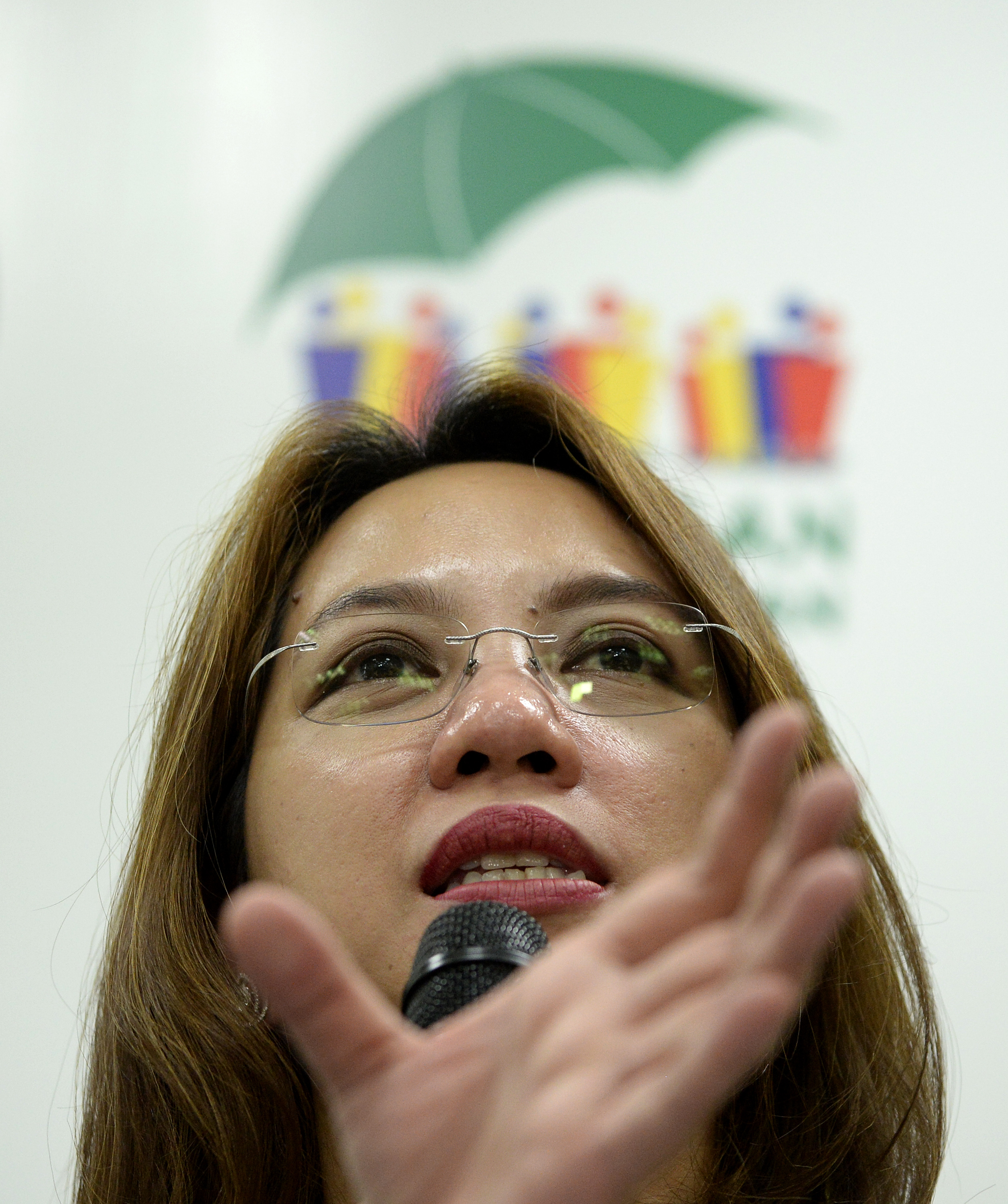 Department of Health (DOH) secretary Janette Garin gestures during a press conference on the Zika Virus at the DOH headquarters in Manila on March 14, 2016.  The DOH announced that it will strengthen its monitoring against the Zika Virus and called all pregnant women to be more careful against mosquito bites during the day. / AFP / NOEL CELIS