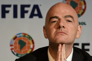 "(FILES) This file photo taken on March 31, 2016 shows FIFA President Swiss Gianni Infantino at a press conference in Bogota. The signature of new FIFA president Gianni Infantino has cropped up in the so-called ""Panama Papers"" in connection with questionable TV rights sales in South America, the German newspaper Sueddeutsche Zeitung behind the mass leaks reported on April 5, 2016. / AFP / LUIS ACOSTA"