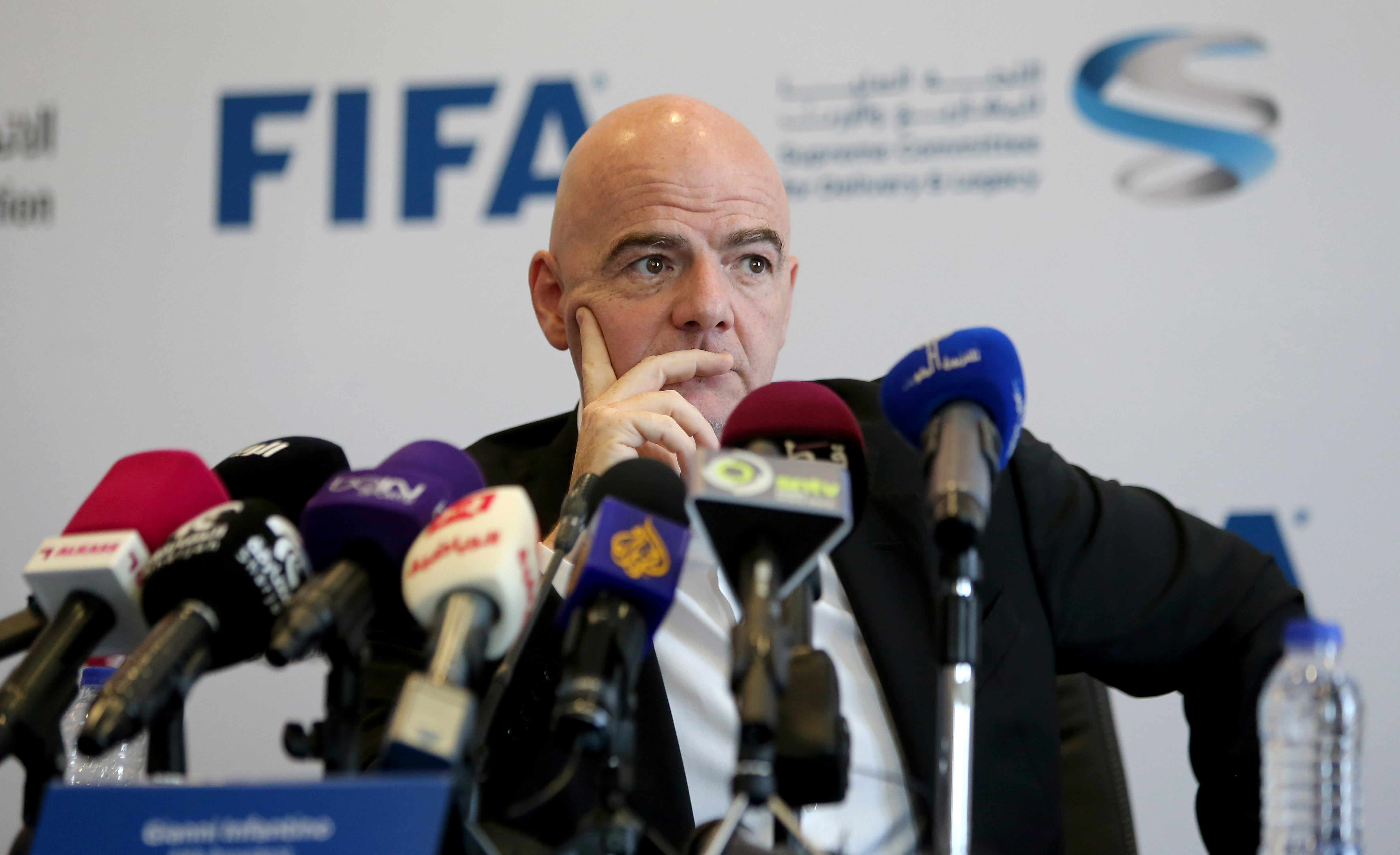 "FIFA President Gianni Infantino attends a press conference in the Qatari capital Doha on April 22, 2016. Infantino announced that a new independent committee would be set up to monitor conditions for labourers working to build stadia for the 2022 World Cup in Qatar. Speaking during his first visit to Doha as head of world football's governing body, Infantino said he was ""confident we are on the right track"" after a string of alleged rights violations during the tournament's construction phase. He said the new committee ""shows that the mechanisms in place are working related to FIFA World Cup"". / AFP PHOTO / KARIM JAAFAR"