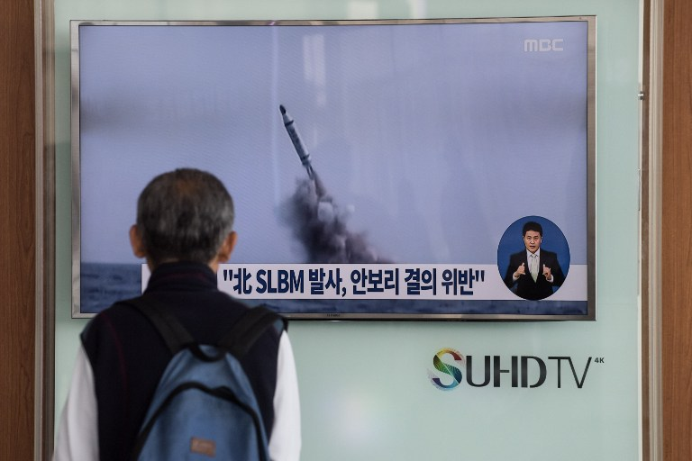 "A man watches a television news channel in Seoul showing footage of a North Korean missile launch on April 24, 2016. North Korean leader Kim Jong-Un hailed a submarine-launched ballistic missile (SLBM) test as an ""eye-opening success"", state media said on April 24, declaring Pyongyang has the ability to strike Seoul and the US whenever it pleases. / AFP PHOTO / STF"