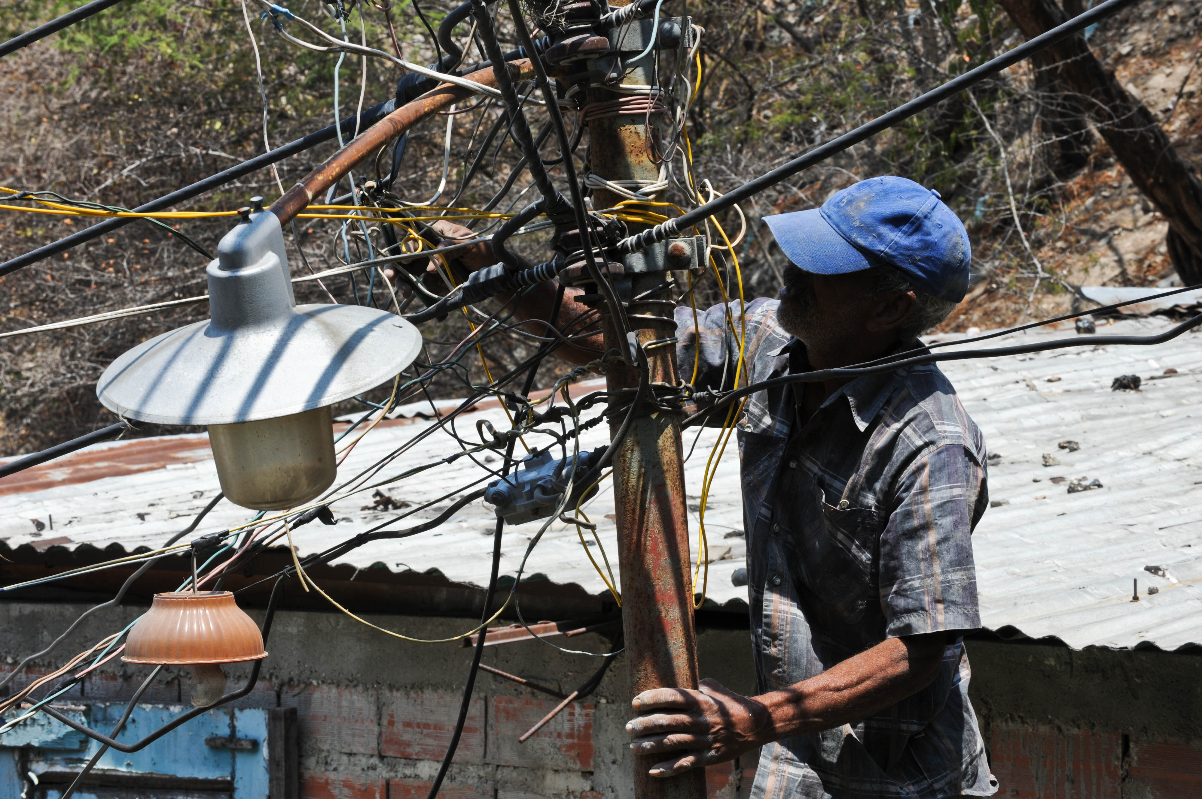 Wiring Money Illegally Venezuela To Ration Electricity In Power Crisis A Man Wires His House The Public Network Caracas March 4